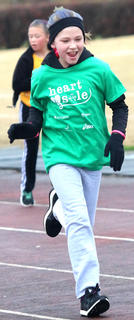 Lebanon Middle School Heart & Sole participant Laura Thomas makes her way around the track.