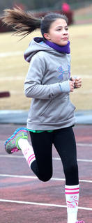 Brianna Knopp makes running 3.1 miles look easy as she coasts around the track Saturday morning. Knopp is a Heart & Sole participant at Lebanon Middle School.