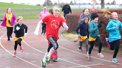And they're off! Girls on the Run participants show what running like a girl really means during the practice 5k Saturday morning at the Marion County High School track. Pictured, from left, are Rose Caldwell, Phebe Jones, Scottlyn Buckman, Piper Jones, Reece Caldwell, Lillian Wilkerson and Kristin Miles.