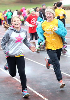 The first-ever Marion County Girls on the Run and Heart & Sole Practice 5k was held Saturday, Nov. 19, at the Marion County High School track. All of the amazing girls who participated will also be attending the Girls on the Run Central Kentucky 5k in Lexington on Dec. 3. Jazmine Hourigan and Nicole Richardson, both Glasscock Elementary School Girls on the Run participants, show off their beautiful smiles as they run around the track Saturday morning.