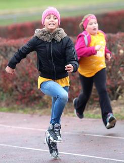 Sylvia Hernandez sprints around the Marion County High School track during the first-ever Marion County Girls on the Run and Heart & Sole Practice 5k, which was held Saturday morning, Nov. 19.