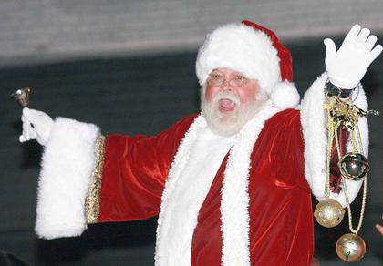 Santa Claus waves to the crowd during the parade.