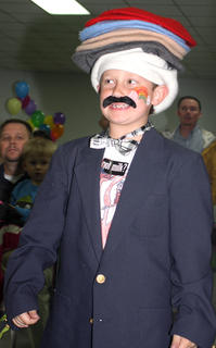 """Lebanon Elementary School student Cody Ballard performs in a skit based on the book """"Caps for Sale"""" with students from the 21st Century Community Learning Center."""