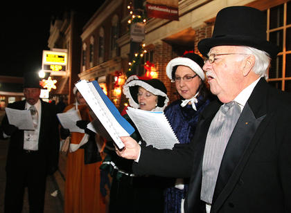 A group of Christmas carolers entertain the crowed during Dickens Christmas Friday evening. Pictured are Wendell Luckett, Nancy Luckett, Janet Mattingly, Frankie Reynolds, Sue Reynolds and Connie Leachman.