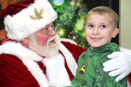 Jeremy Bagwell poses for a photo with Santa Claus.