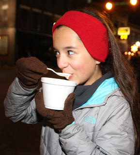 Amira Bowman enjoys a bowl of chili during Dickens Christmas Friday evening in downtown Lebanon. The winner of the Marion County Chamber of Commerce's Chili Cook-off was Tommy Glasscock.