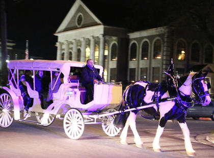 Around the Town Carriage & Stagecoach in Bardstown take Dickens Christmas attendees on carriage rides on Spalding Avenue Friday evening.