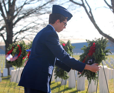 Chief Master Sgt. Selliers, representing Civil Air Patrol Squadron 122, presents a special wreath in honor of Prisoners of War/Missing in Action during the Wreaths Across America ceremony.