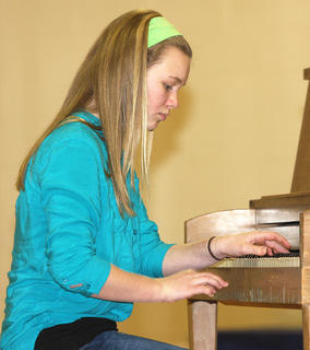 Jane Palagi is all business as she plays the piano.