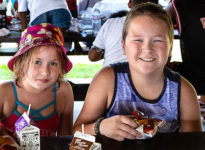Sabrina and Steven Coon picnic under the pavilion during the end of Summer Dream Academy celebration recently.