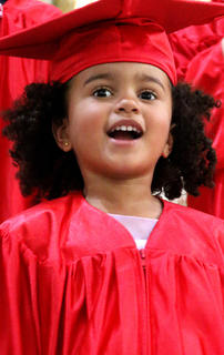 Lyla Smith, 3, performs during the preschool graduation ceremony.