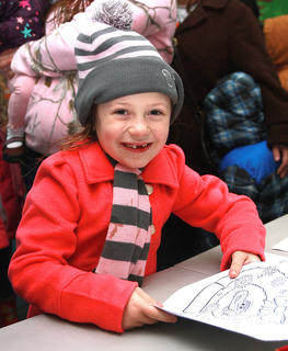 Jocelyn Cochran, 7, was all smiles while waiting in line to see Santa.