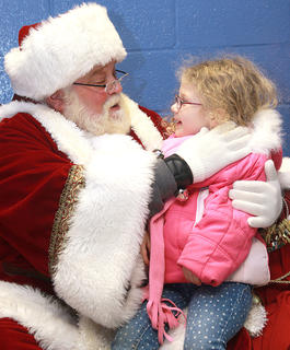 Santa and Jaylynn Cochran, 5, chat about what she would like for Christmas.