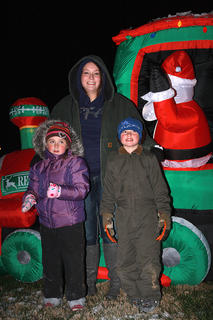 Abbi, 6, and Jacob Million, 8, poses for a photo with Nikki Purdom in front of one of the inflatables.