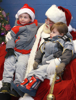 Kieran Jones, 4, and his brother Kooper, 2, were the first in line to visit with Santa.