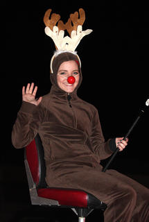 Abby Miles is Rudolph the Red-Nose Reindeer fishing.