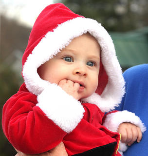 The City of Bradfordsville hosted its annual Christmas in the Country celebration Saturday. The festivities included a parade, best decorated house contest and a turkey and ham supper. Four-month-old Destyn Sheperson waits anxiously for the parade to begin.