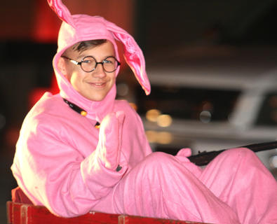 """Camden Stiles is dressed as Ralphie from """"A Christmas Story"""" in his bunny rabbit pajamas. Stiles was a part of The Lancaster Agency's float."""