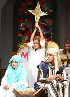 Gladys Herdman, being played by Elizabeth Russell, gets the honor of not only being an angel in the Christmas pageant, but she also gets to hold the Star of Bethlehem.