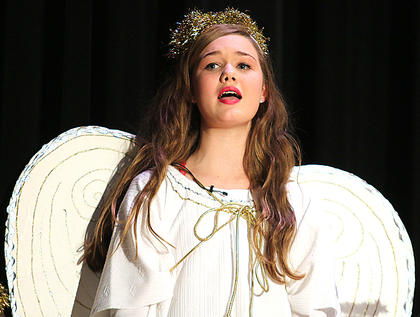 Libby Palagi plays the part of a singing angel.