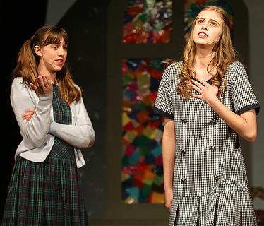 Jessica Thomas, left, playing the part of Beth Bradley, takes up for her mother who is trying to direct the Christmas pageant while her friend, Alice, being played by Cassandra Thomas, keeps pointing out all the things Beth's mom is doing wrong. Jessica and Cassandra are sisters in real life.