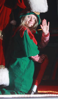 Vanessa Van Why stands in for one of Santa's many elves during the parade.