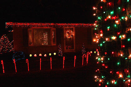 Shane and Lincoln Richardson and their children won the award for best decorated house in Bradfordsville.