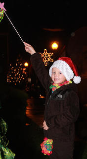 Tori Gribbins, 6, waves the magic wand to light the Christmas tree outside of the Marion County Heritage Center Friday evening during Dickens Christmas.
