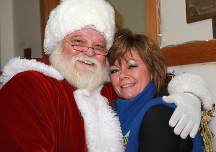 Santa gives Lisa Kearnes a big hug inside the Marion County Heritage Center on Friday.