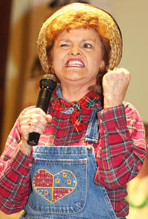 "The St. Joe community hosted its own version of the variety show ""Hee Haw"" Saturday evening, Dec. 8. The evening featured country music, corny jokes and lots of laughs. Pictured is Judy Miles shows the true meaning of the song, ""Fist City."""