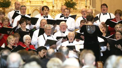 Members of the Mid-Kentucky Chorus sing from the front of St. Augustine Church.