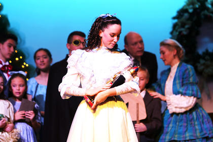 Clara, played by Elli Wilson, receives her magical Nutcracker at her family's annual Christmas party.