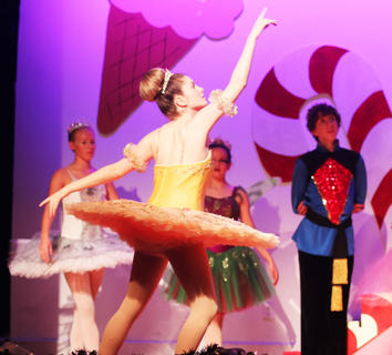 The Sugar Plum Fairy, Reili Farmer, chooses Clara to be the princess for the evening, and honors her with a dance by herself and her friends. Also pictured is Briana Mardis, Faith Warren, and Luke Hesson.