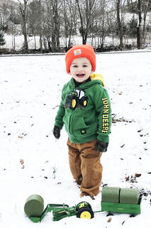 Little Thomas Bland haul hay in the snow.