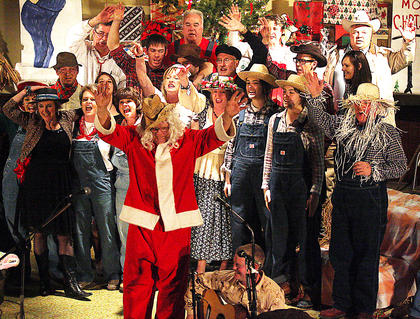 (Front to back) Phillip Buckman (dressed as Santa), Nathan Yaste, Kathy Spalding, Pam Brady, Lewis Clements, Crystal Brady, Jamie Bell, Melody Gordon, Loretto Farmer, Charlotte Mattingly, Abigail Hogan, Ann Claire Hagan, Eddie Buckman, Steven Brady, Cody Farmer, Logan Mattingly, Danny Brady, Larry Thomas, Loren Brady, Terry Mills, Linda Small and Doug Thompson sing HEE HAW's closing theme song at the end of the play.