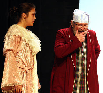 Ebenezer Scrooge, played by Lynn D. Farris, talks with the Ghost of Christmas, played by Dana Allen.