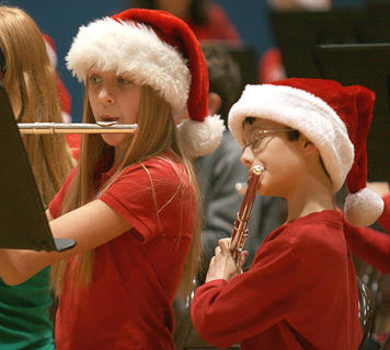 Taylor Richardson and Zachary Essex play the flute.