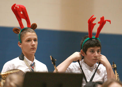 Nate Hoppes, left, and Jakob Benningfield stand to be recognized along with the rest of the saxophone players.
