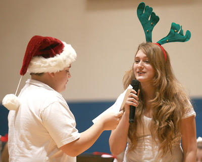 Trevor Mudd, left, and Emma Humphress tell a Christmas tale written by students to incorporate the titles of the songs they played.