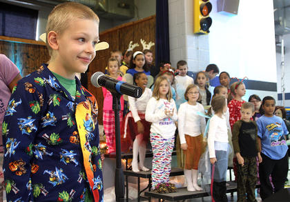 "Jacob Releford recites a portion of ""'Twas The Night Before Christmas."""