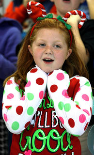 Makenna Wheatley, dressed in some festive pajamas, sings during the performance.