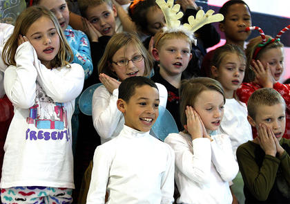 Third grade students sing together during the performance. They are, bottom row from left, Chanse Smith, Lani Gribbins, Kevin Hovious; middle row from left, are Taylor Vaughn, Aubrey Price, Jacob Million, Ava Deering and Clara MacFarlane; back row from left, are Sarah Shively, Landon Record, Kylie Summers and Quintin Key.