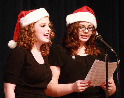 Carrie Fowler, left, and Sara Beth Thompson sing a Christmas song during a set change.
