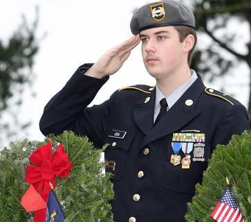 Marion County High School ROTC cadet John Cox salutes during the ceremony. His wreath was in memory of those who served and are serving in the United States Navy.