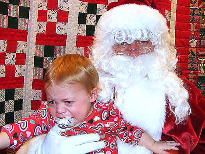 Hadley Tatum, who was just one-year-old when this photo was taken, tries to escape Santa's grip. She is the daughter of Jason and Heather Tatum of Lebanon.