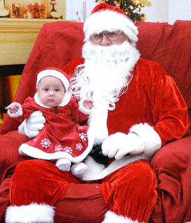 Pictured is Cheyenne McElroy with Santa. She will turn five months old on Dec. 24. Her parents are Elizabeth McElroy and Andy Adkins.