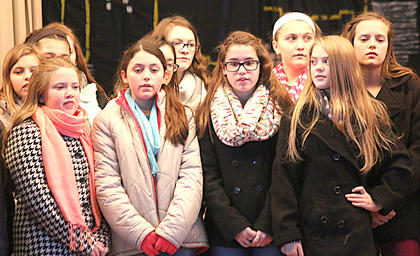 Students sings a Christmas song so the magical cheerfulness can get Santa's sleigh back in the air.