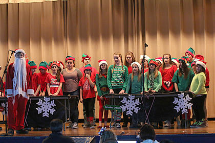 Santa, played by David Buckman, leads everyone in a Christmas song.