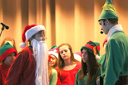 David Buckman and Alex Tungate say their goodbyes as Buddy the Elf makes his way to New York City.