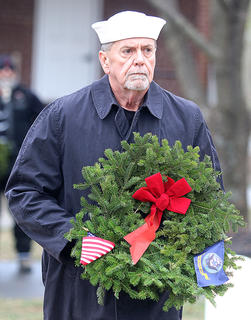 Greg Parrent presents a remembrance wreath in memory of those who served and are serving in the United States Navy.